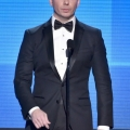 Host Pitbull speaks onstage at the 2014 American Music Awards