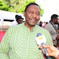 mr-emma-ogosi-at-the-coson-in-the-church