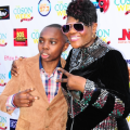 talented-saxophonist-tj-sax-and-bouqui-at-the-coson-in-the-churchs-red-carpet