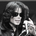 """**FILE** Michael Jackson delivers his speech to fans during an event """"Fan Appreciation Day"""" in Tokyo on March 9, 2007. Jackson is """"a little bit under the weather,"""" but has not sought hospital treatment, his spokeswoman said Thursday, March 29, 2007. (AP Photo/Itsuo Inouye)"""
