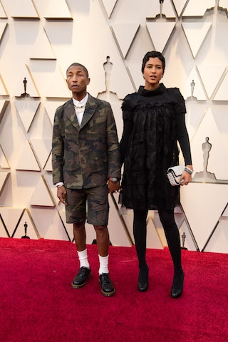 Pharrell Williams (L) and Helen Lasichanh arrive on the red carpet of The 91st Oscars® at the Dolby® Theatre in Hollywood, CA on Sunday, February 24, 2019.