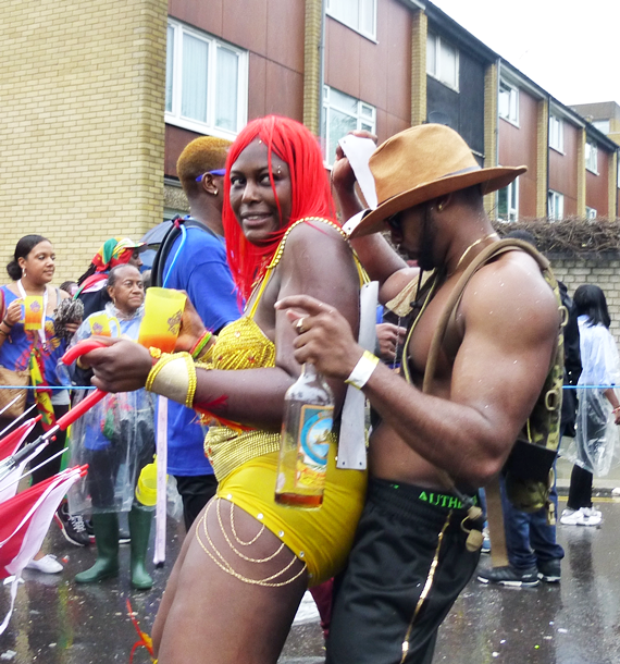 P1050316 Dont rain on our parade! Millions refuse to let the rain dampen their Carnival spirit
