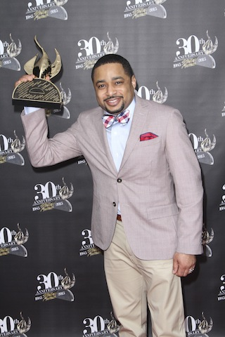Smokie Norful with his award