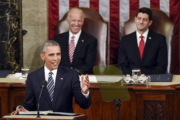 Vice President Joe Biden and House Speaker Paul Ryan of Wis., listen as President Barack Obama gives his State of the Union address to a joint session of Congress on Capitol Hill in Washington, Tuesday, Jan. 12, 2016. (AP Photo/Susan Walsh)