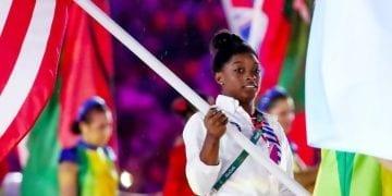 Gymnast Simone Biles parades the American Flag at the Rio Olympics closing ceremony