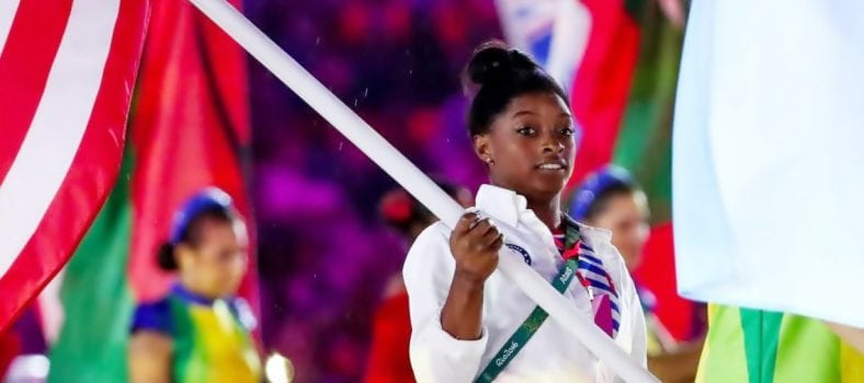 Gymnast Simone Biles parades the American Flag at the Rio Olympics closing ceremony