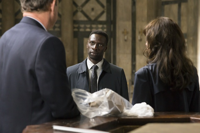 Bouchard (Omar Sy) catches up with Langdon (Tom Hanks) and Sienna (Felicity Jones) in the Baptistry in Columbia Pictures' INFERNO.