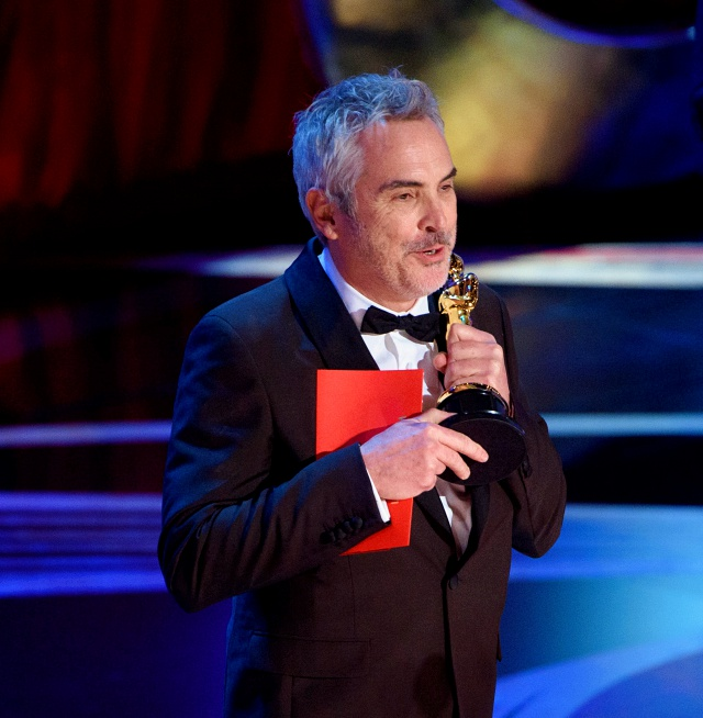 Alfonso Cuarón of Mexico accepts the Oscar® for best foreign language film