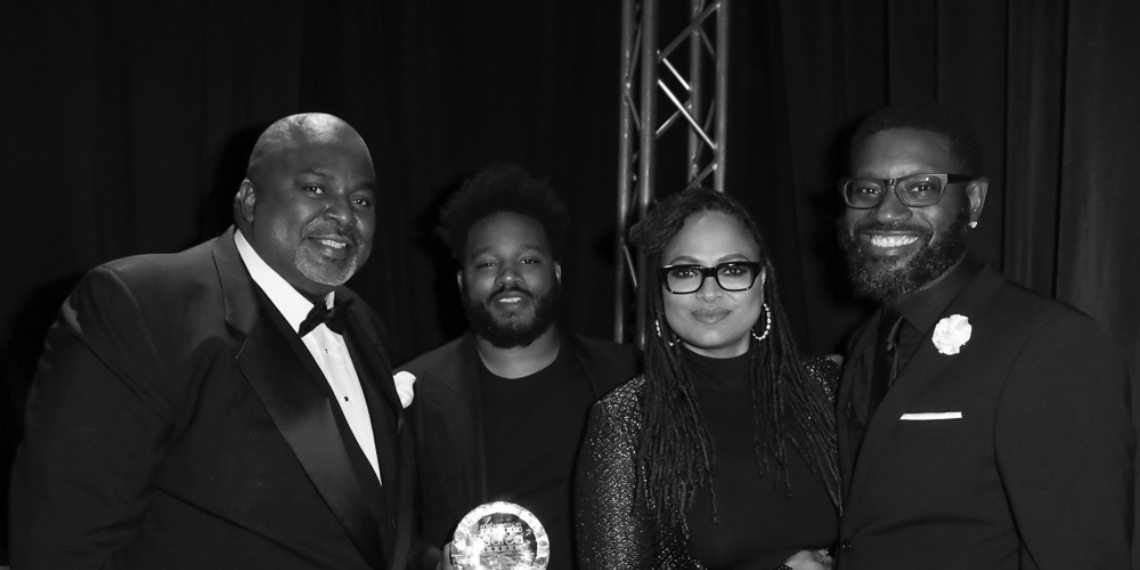 AAFCA co-founder and president Gil Robertson (L), Black Panther director Ryan Coogler, filmmaker Ava DuVernay, AAFCA co-founder Shawn Edwards (R) backstage at the 10th Annual AAFCA Awards