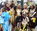 Don't rain on our parade! Millions refuse to let the rain dampen their Carnival spirit